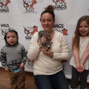 happy children adopt a kitten at WAGS