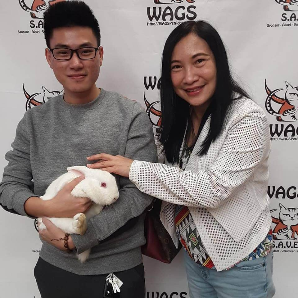 mother and son adopt a bunny at WAGS