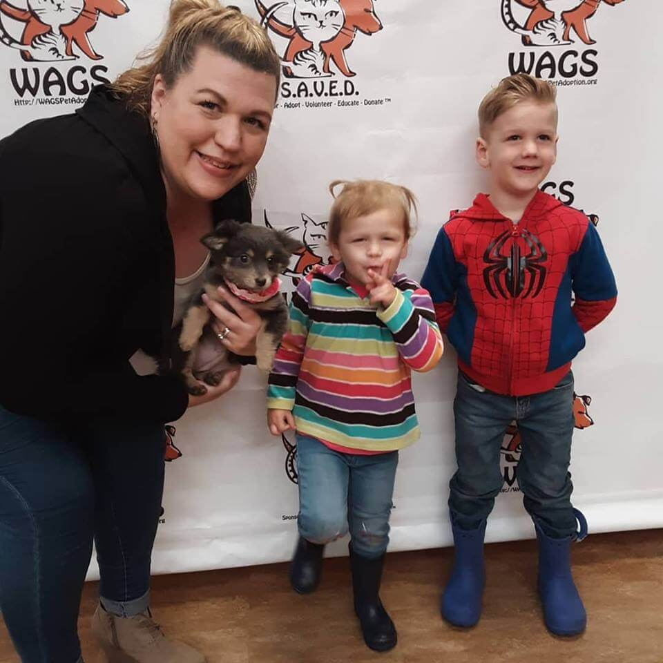 cute kids and their adopted puppy WAGS