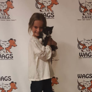 adorable kid adopt a cat at WAGS