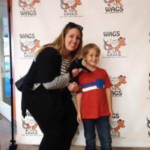 sweet child and her mother adopt a cat wags