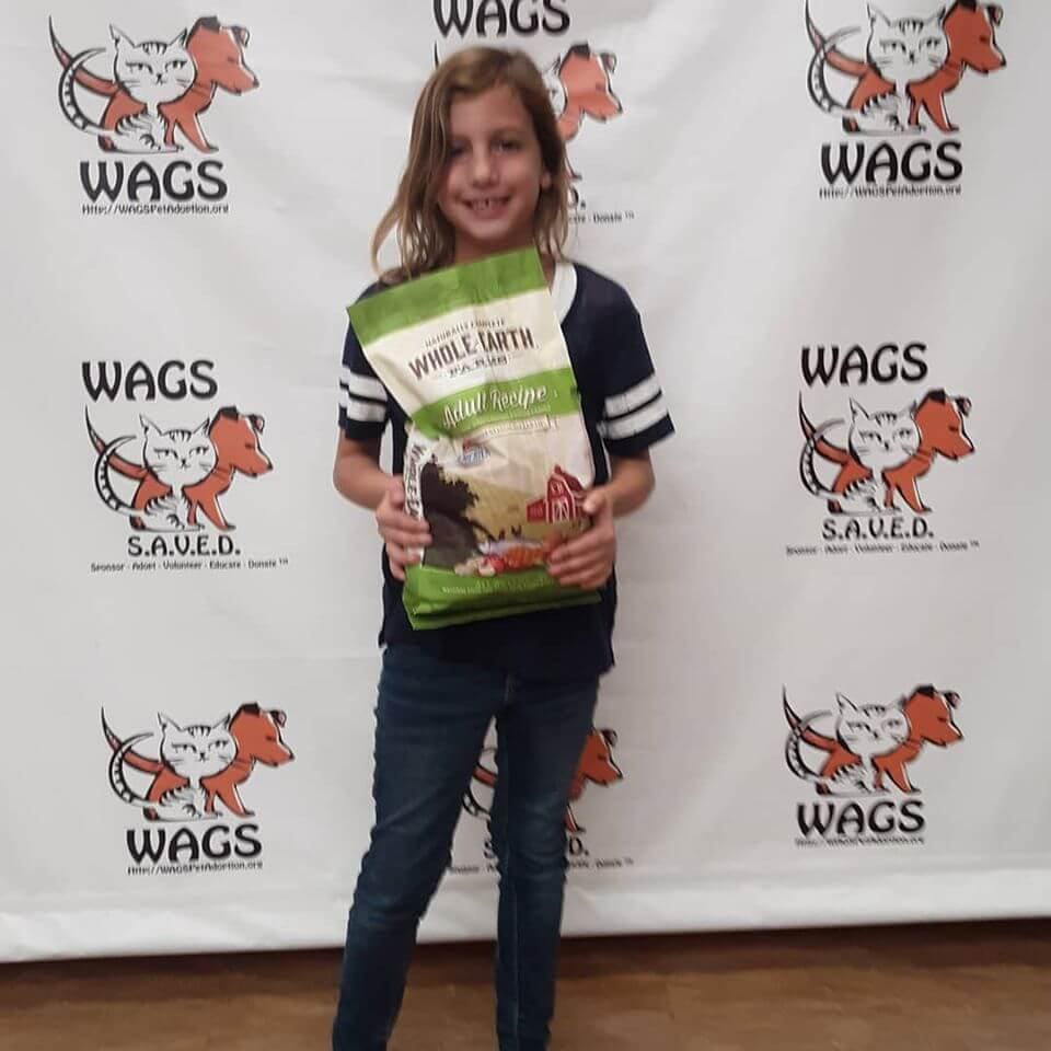 giana with pet food and treats donation WAGS