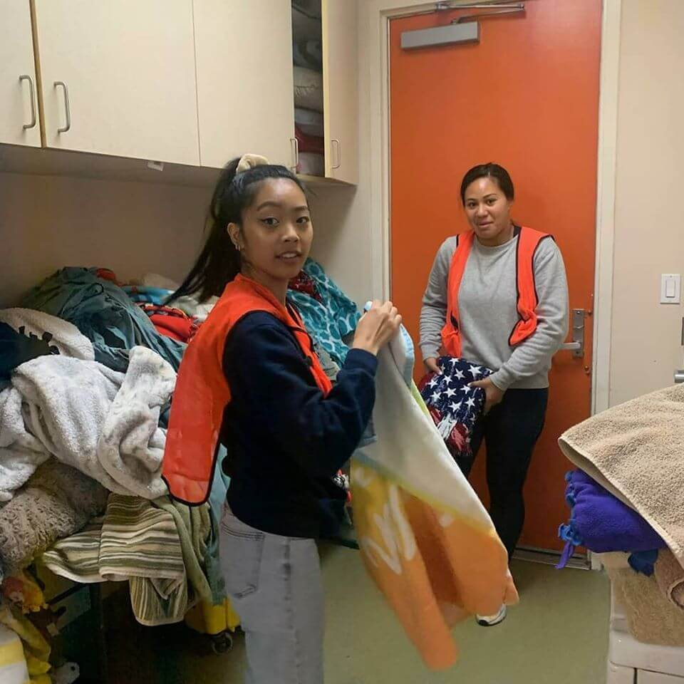 two volunteers for WAGS taking care of laundry